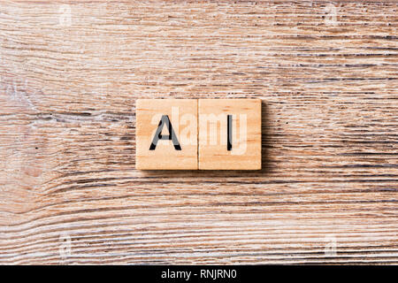 Artificial Intelligence word written on wood block. AI text on wooden table for your desing, concept. - Stock Photo