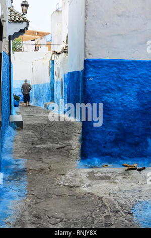 Blue painted narrow alley in the old town of Rabat, Morocco - Stock Photo