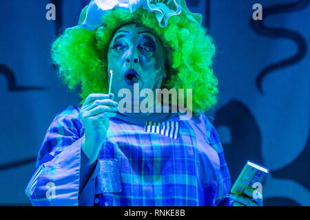 The Pantomime Dame (man dressed as a grotesque caricature of a woman) in an amateur non-professional  local theatre company (The Wardens) performance on stage at Aberystwyth Arts Centree. January 2019 - - Stock Photo