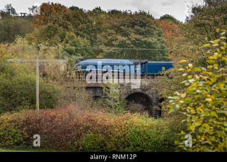 The A4 Pacific Sir Nigel Gresley crosses the Burrs Park viaduct. The East Lancashire Railway Autumn steam gala Oct 2014. - Stock Photo