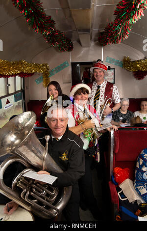 UK, England, Lancashire, East Lancashire Railway, Santa Spacial train, brass band entertaining passengers - Stock Photo