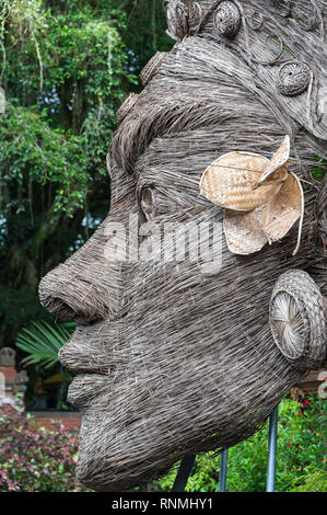 Bali, Indonesia : Woven sculpture of a Hindu Goddess, Tirta Empul, or Holy Water Temple, near Ubud. Close up detail, wicker artwork in garden setting - Stock Photo