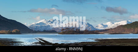Loch Leven and the mountains to the west of Loch Linnhe from Glencoe village. Eilean Munde is the island in the centre. - Stock Photo