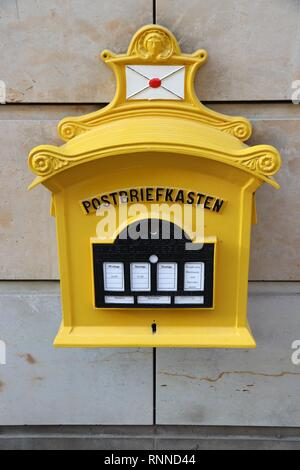 DRESDEN, GERMANY - MAY 10, 2018: Deutsche Post (German Post) mailbox in Dresden. Deutsche Post delivers more than 60 million letters every day, making - Stock Photo