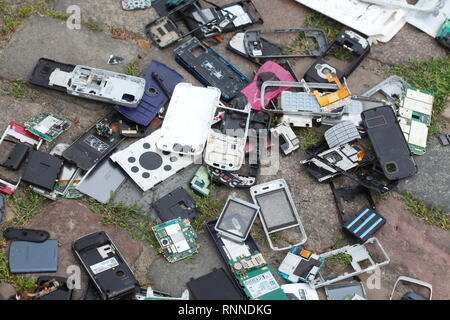 Electronic waste, old broken smartphones lying on the floor, Germany, Europe - Stock Photo