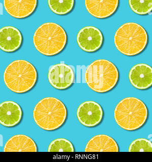Vibrant lemon and green lime slices pattern on turquoise color background. Minimal flat lay top view food texture - Stock Photo