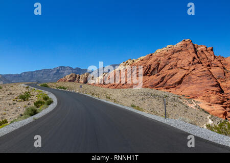 The Scenic Loop Drive heading towards the Calico Hills, Red Rock Canyon National Conservation Area, Las Vegas, Nevada, United States. - Stock Photo