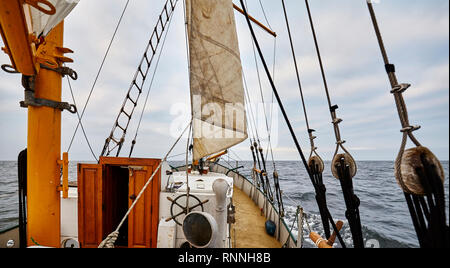 Sailing an old schooner on a rainy day. - Stock Photo
