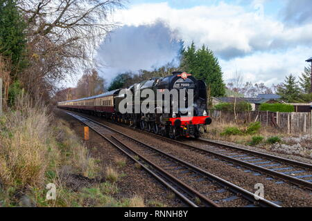 British Railways (BR) Standard Class 7 number 70000 Britannia passes Weston Ryhn level crossing while on a special charter. - Stock Photo
