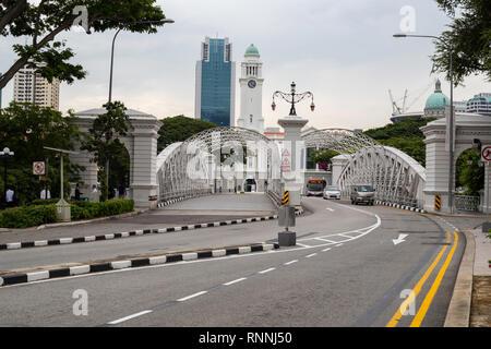 Anderson Bridge over Singapore River, Singapore.  Victoria Concert Hall in background. - Stock Photo