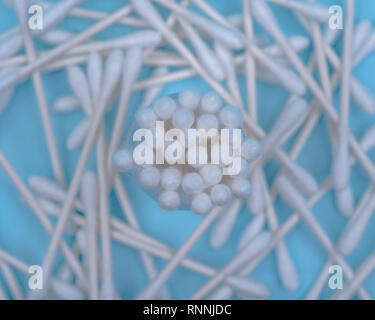 Organic double end white cotton-tipped  ear and make up swabs, buds isolated on blue under pad. - Stock Photo