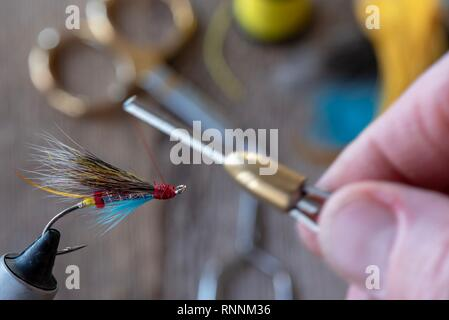 Tying a classic and colorful salmon wet fly. - Stock Photo