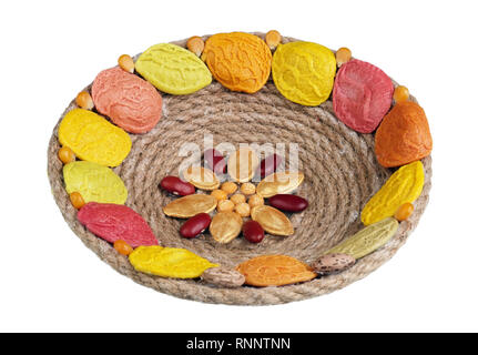 Easter handmade nest  made from  rope. past and vegetables seeds. Isolated on white macro - Stock Photo