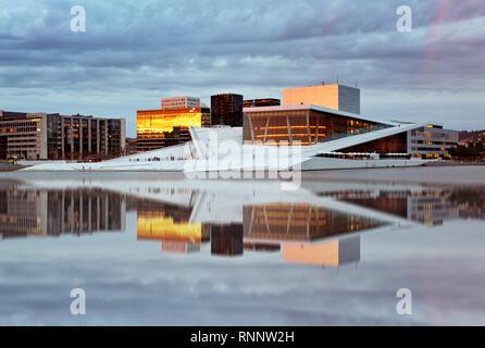 OSLO, NORWAY - JUNY 1: National Oslo Opera House shines at sunrise on Juny 1, 2014. Oslo Opera House was opened on April 12, 2008 in Oslo, Norway - Stock Photo