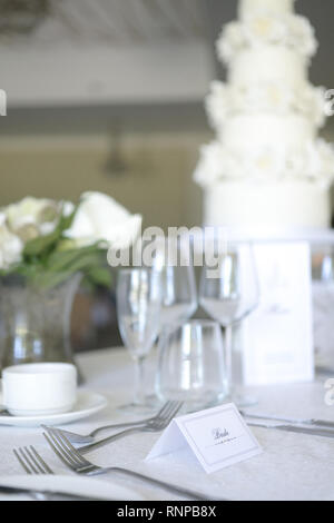 Beautiful table and decorations from an Art Deco themed Wedding, the colour palette is white and green, it is bright and very subtle - Stock Photo