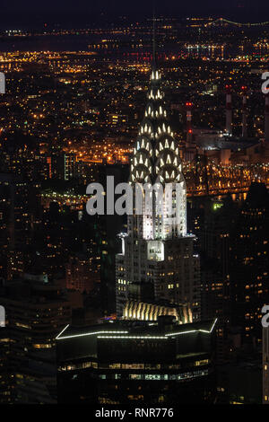 Illuminated Chrysler building Art Deco top from the Empire State Building, Art Deco skyscraper in Midtown Manhattan,, New York City, USA - Stock Photo