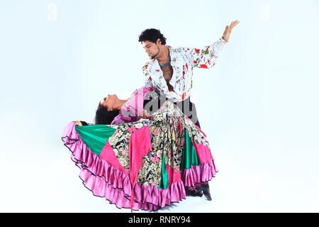 dance Duo performing a Gypsy dance.isolated on white . - Stock Photo