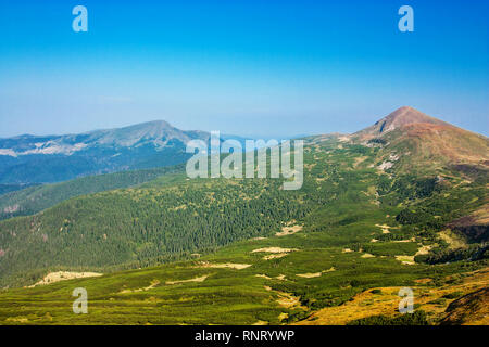 Panoramic view of the rocky mountains of the Carpathians, Ukraine. Beautiful view of the Montenegrin ridge. - Stock Photo