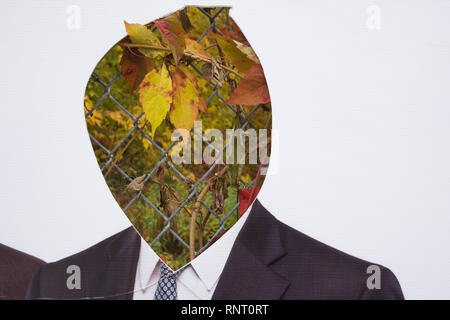 Fence and vines cut-out portrait of a man in a business suit - Stock Photo