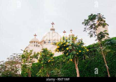 Christian Orthodox Coptic Church in Sharm El-Sheikh, Egypt. Exterior on rainy day surrounded with trees - Stock Photo