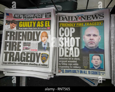 Headlines of the New York Daily News and the New York Post on Wednesday, February 13, 2019 report on the death of NYPD Detective Brian Simonsen by friendly fire during a previous day's robbery of a T-Mobile store in Richmond Hill, Queens. (© Richard B. Levine) - Stock Photo