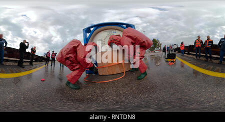 360 View of Firefighters with protective gear seal a leaking