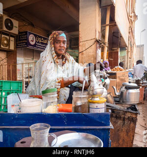 Khartoum, Sudan, February 5. 2019: Coffee and tea seller on a dusty street in the center of the capital with many ingredients for coffee - Stock Photo