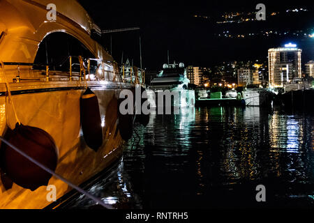Night time photo of Dukley Marina, Budva, Montenegro. Life reflected in the Adriatic Sea. - Stock Photo