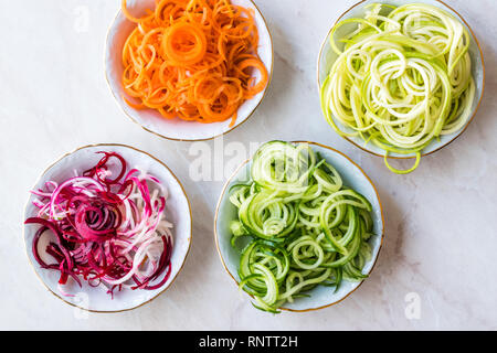 Spiralized Vegetables Noodle Carrot, Beetroot, Zucchini and Cucumber. Organic Food. - Stock Photo