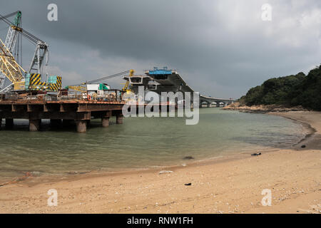 Hong Kong, Zhuhai, Macau Bridge under construction on the Sha Lo Wan Beach near Tung Chung in the Hong Kong New Territories. - Stock Photo