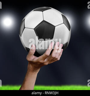Man holding Soccer ball - Stock Photo