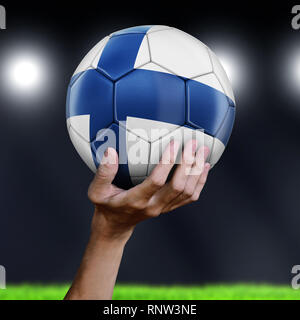 Man holding Soccer ball with flag - Stock Photo
