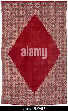 Ceremonial cloth and sacred heirloom (dodot) with central diamond field - Stock Photo