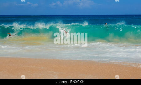 WAIKIKI, UNITED STATES OF AMERICA - AUGUST 6 2015: a shot of body surfers at sandy beach - Stock Photo