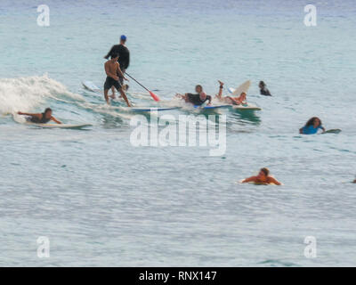 WAIKIKI, UNITED STATES OF AMERICA - AUGUST 9 2015: a crowd of swimmers and surfers at waikiki beach - Stock Photo