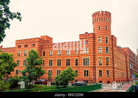 House with round tower with red brick wall in wroclaw, poland on white sky background. Architecture, exterior, structure, design concept - Stock Photo