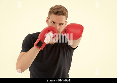 Man boxing isolated on white. Macho in red boxing gloves. Ready to fight. Confident sportsman. Energy and power, knockout. Fitness trainer at workout. Punching. Future aim and success - Stock Photo
