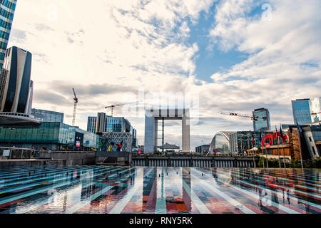 Paris, France - September 30, 2017: fountain basin with mosaic surface in la defense district on urban background. Architecture, design, construction concept. Monument, attraction, landmark - Stock Photo