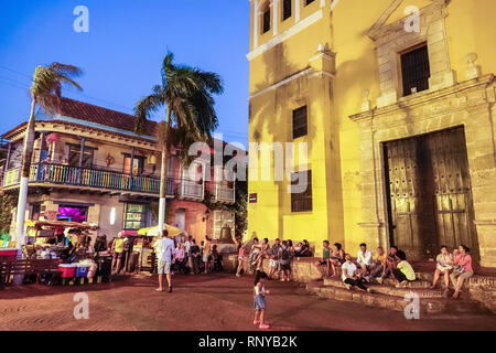 Cartagena Colombia Old Walled City Center centre Getsemani Plaza de la Trinidad Holy Trinity Square night nightlife outdoor gathering place Hispanic r - Stock Photo