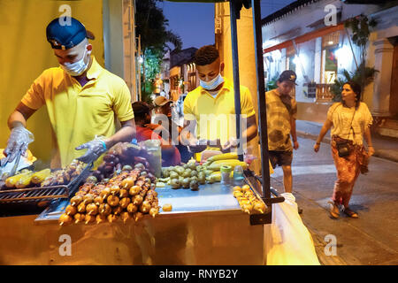 Cartagena Colombia Old Walled City Center centre Getsemani Plaza de la Trinidad Holy Trinity Square night nightlife outdoor gathering place Hispanic s - Stock Photo