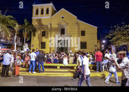 Cartagena Colombia Old Walled City Center centre Getsemani Plaza de la Trinidad Holy Trinity Square church exterior night nightlife gathering place Hi - Stock Photo