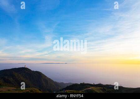 Sunrise time on the top of mountain in Thailand - Stock Photo