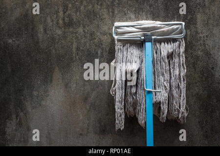Old mop and dirty wall texture - Stock Photo