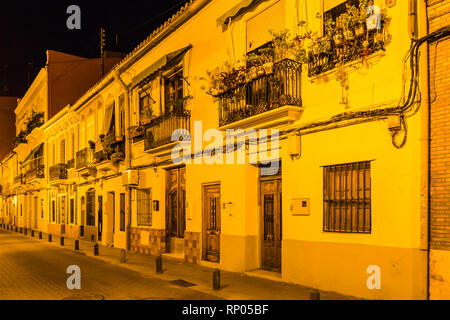 Cityscape Valencia in Spain with narrow ancient streets during the night night - Stock Photo