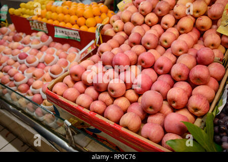 Red apples, oranges and lemons - Stock Photo