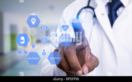Close-up of indian physician choosing with index finger medical text hexagon button on transparent display as futurist technology medicine concept - Stock Photo