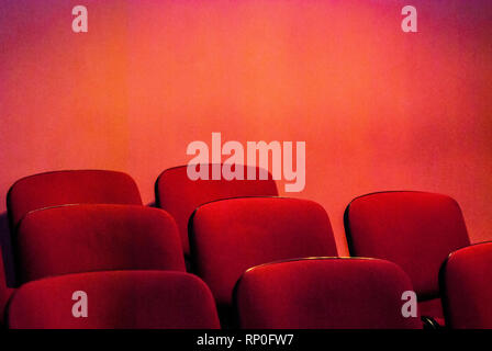 Red empty theater seats. Shallow DOF. - Stock Photo