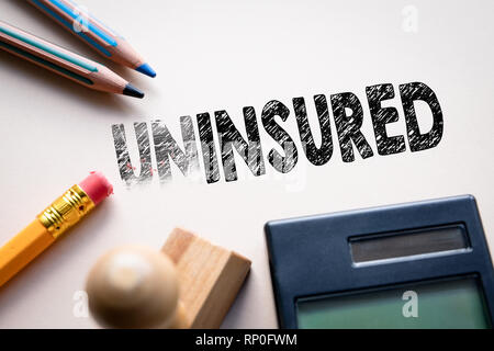 Making uninsured in to insured by eraser. Concept for action and reaching goals - Stock Photo