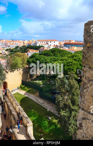 Lisbon, Portugal - March 30, 2018: People at Saint George Castle and city panorama with colorful houses - Stock Photo