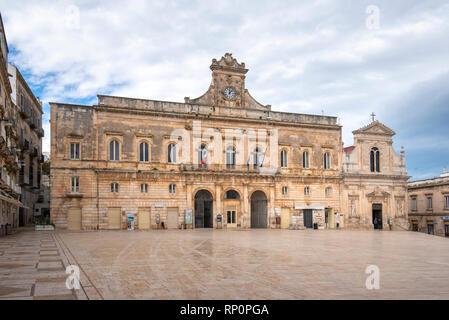 Main square with city hall in the center of Ostuni, Apulia, Puglia, Italy. Piazza della Liberta and Church Chiesa di San Francesco D'Assisi cathedral - Stock Photo